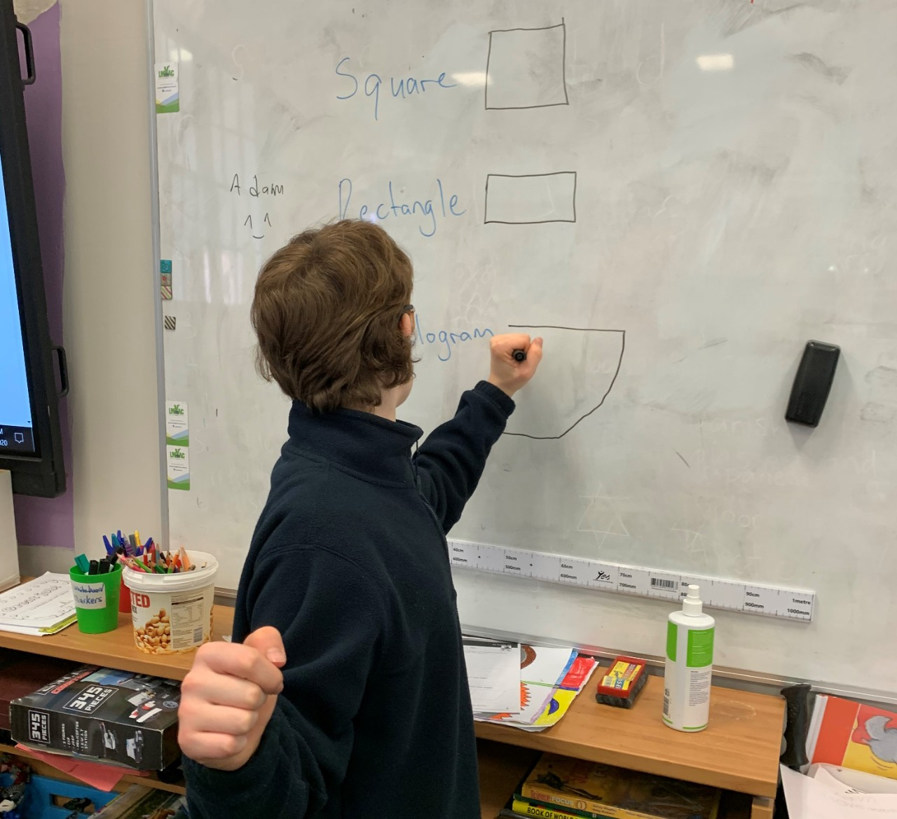 Student using whiteboard